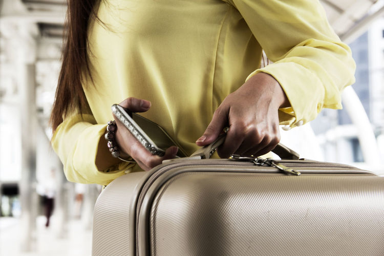 luggage. Big Bag Tourist Travel Travel Photography Walk Adult Bag Casual Clothing Close-up Day Holding Human Hand Indoors  Luggage Luggage Trolleys Luggage, Travel  Midsection Occupation One Person People Real People Standing Tourism Women Young Adult
