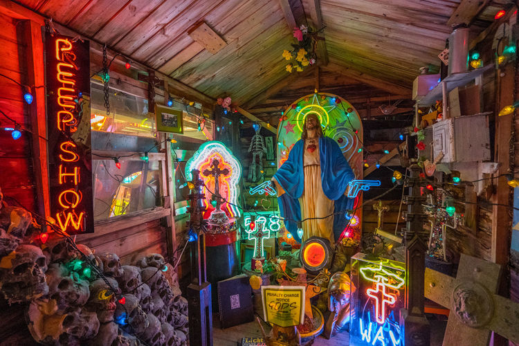 Neon signs and decorations at God's Own Junkyard in Walthamstow, London. Bright Christmas Colors Colourful Jesus Neon Signs Shrine City Lighting Illuminated Multi Colored Neon Neon Lights Spirituality Urban Urban Lighting