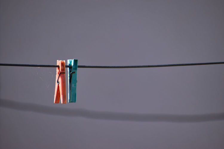 The clothes springs Clothes Springs Hanging Clothesline Clothespin No People Clothing Still Life Clip Close-up Nature Copy Space Low Angle View Day Rope Springs Shadow Laundry Chores Focus On Foreground Housework Group Of Objects