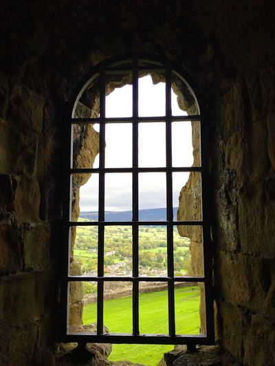 Looking out across Castleton from the castle the gave the village its name Autumn Castleton History Architecture History Window Indoors  History Day Arch Architecture No People Castle Ancient Nature