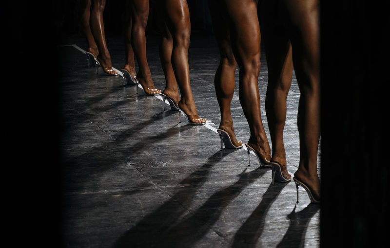 Low section of people standing in high heels