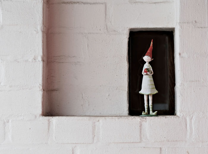 Architecture Background Building Exterior Built Structure Childhood Copy Space Day Figurine  Home Decoration  Negative Space No People Outdoors Red Hat Simplicity Small Window Smile Toy White Wall Whitewashed