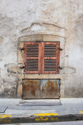 Rusty Architecture Built Structure Building Exterior Old No People Closed Day Window Wall - Building Feature Weathered Building Wall Outdoors Metal Security Shutter Safety Protection Brick Grate Concrete Lock Corrugated Iron Bad Condition Worn Out Latch Run-down