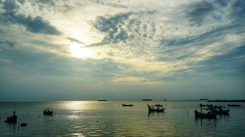 Fishermen port in Bonang Rembang Photography Photooftheday INDONESIA Photography By @jgawibowo Shot By Arif Wibowo Fishing Boat Rembang Indonesia EyeEm Selects EyeEmNewHere Fisherman Sunset Reflection Cloud - Sky Water Sea Sun Sky Silhouette Tranquility Beach Scenics