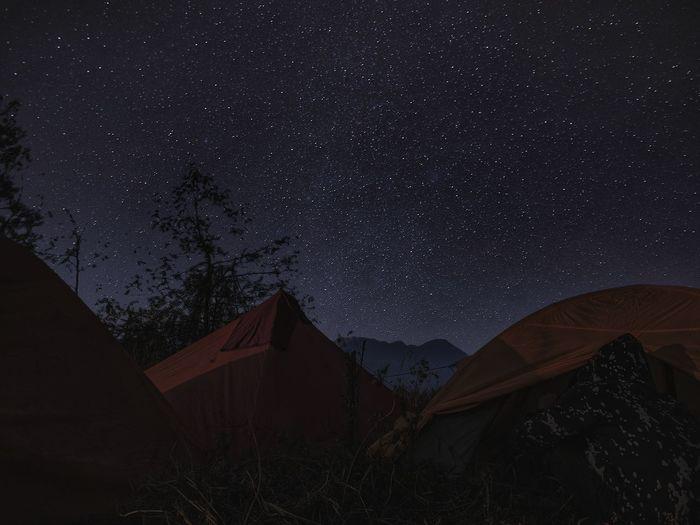 Camping on the mountain peak among sky full of stars