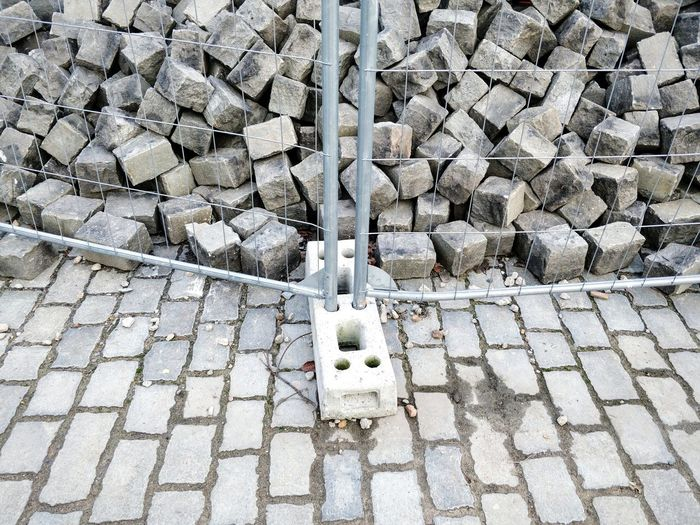 Safety first. Grey Winter Cold Stone Material Stone Fence Fences & Beyond Safety Safety First! Protection Urban Scene Mauerpark Nothing To See Here  Full Frame Stone Tile Cobbled Ground Paving Stone Cobblestone Pile Textured