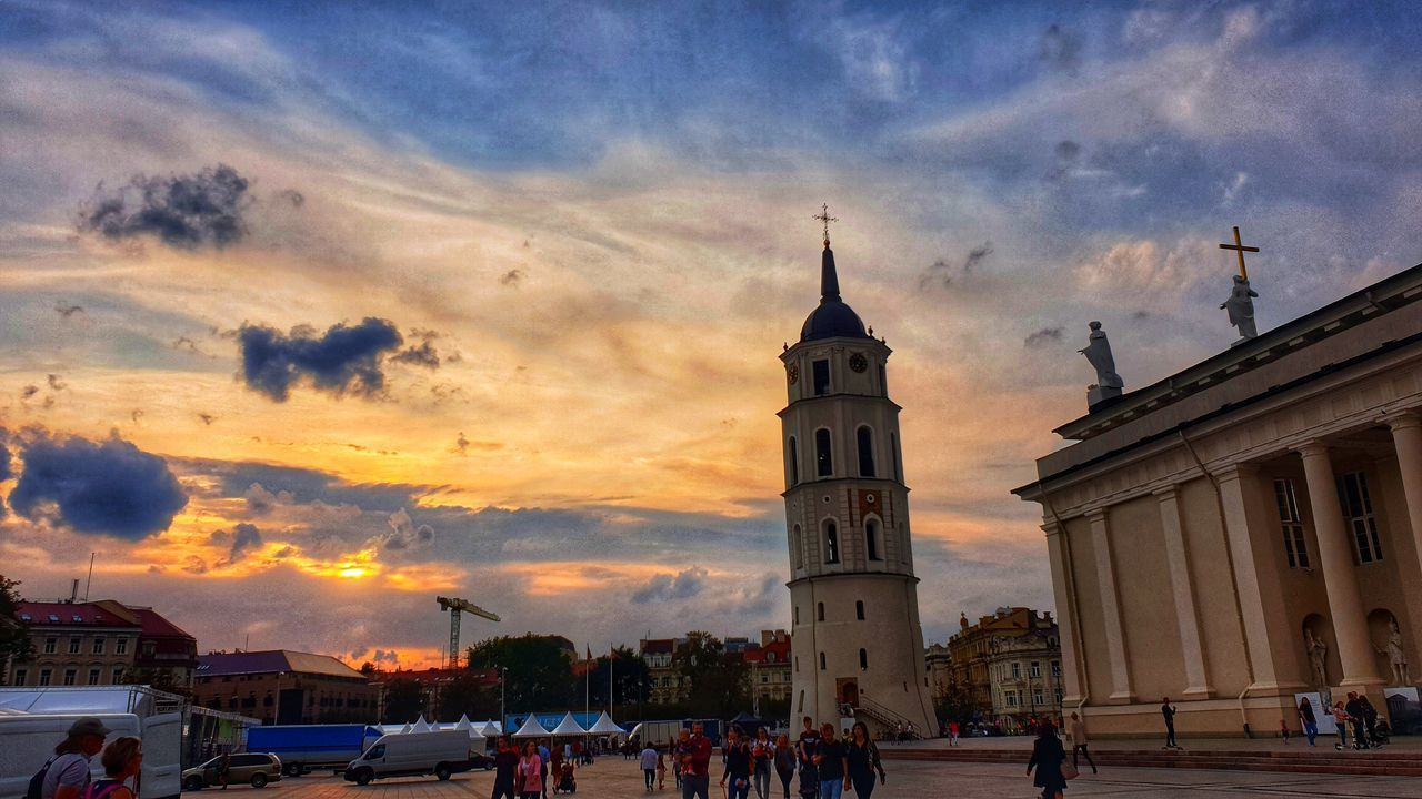 sky, architecture, built structure, building exterior, cloud - sky, sunset, group of people, building, travel, place of worship, nature, religion, real people, men, large group of people, city, travel destinations, belief, spirituality, outdoors