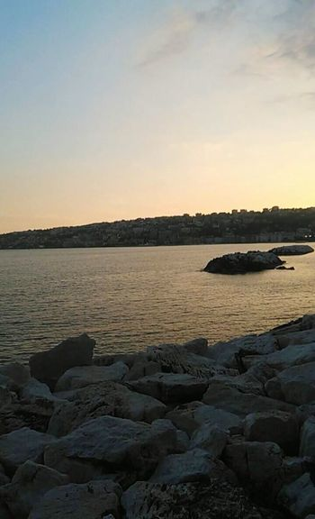 Naples Sunset Landscape Rock - Object Sea Beach Horizon Over Water Beauty In Nature Sky Outdoors No People Nature Outdoor Pursuit Sunlight Blue Vacations Scenics Water Day Naples🌊💙 Napoli Naples Is Wonderful Groyne City