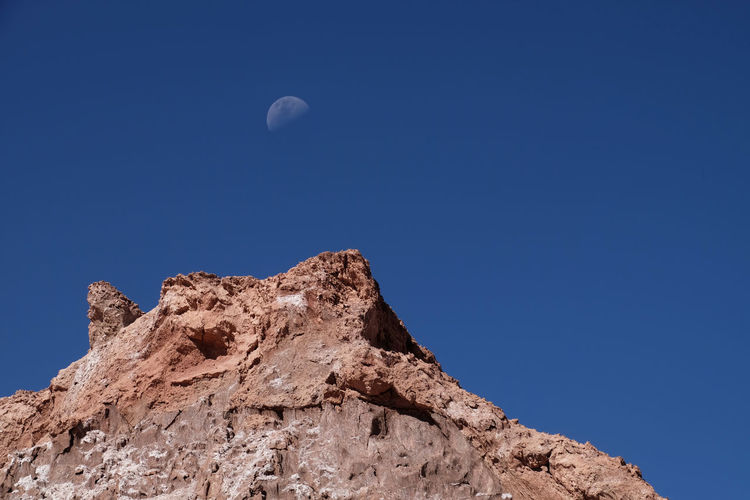first man Moon Sky Rocks Deep Blue Clear Sky Nature Mountain Beauty In Nature No People Rock - Object Astronomy Solid Space Outdoors Formation Mountain Peak Eroded Tranquility Mission Treking Travel Photography Themes Point Of View Rock
