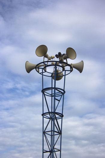 Low angle view of loudspeaker against sky