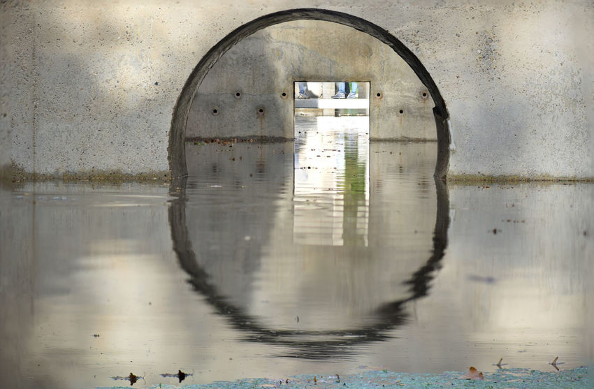 Reflection of a circle on water. See thru Reflection Water Waterfront Day No People Architecture Built Structure Nature Arch Geometric Shape Wet Shape Circle Outdoors Window Building Lake Building Exterior Glass - Material Rainy Season