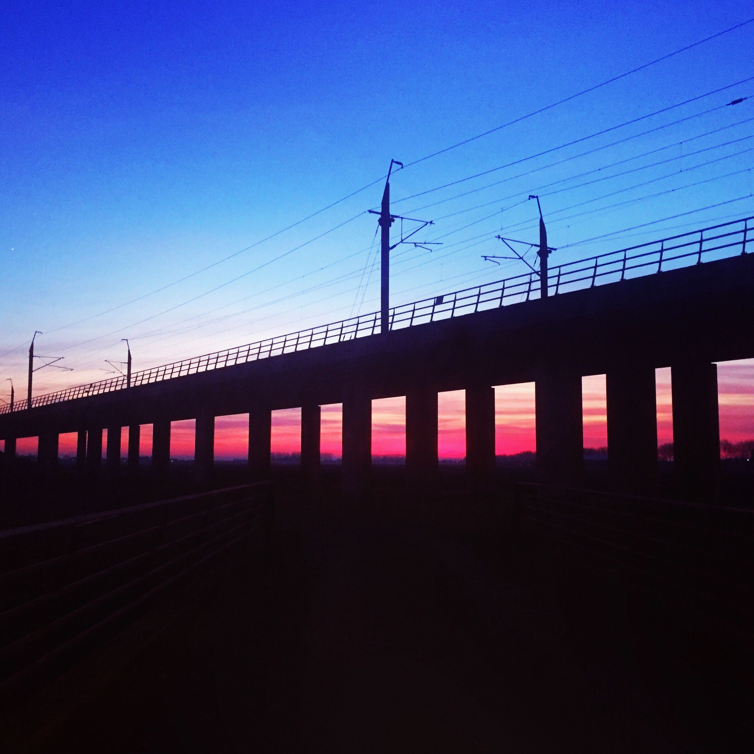 connection, sky, transportation, bridge - man made structure, built structure, power line, silhouette, clear sky, no people, outdoors, electricity, sunset, power supply, architecture, day