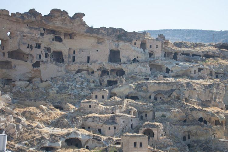 Cavusin in cappadocia against clear sky