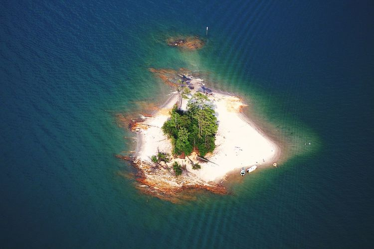 On an island Sea Aerial View Beach Sand High Angle View Tranquility Nature Landscape Beauty In Nature Outdoors Scenics Water Day Tree Backgrounds Aviation Photography Aviationphotography Aerialview Majestic Tranquility Nature Beauty In Nature Tranquil Scene Travel Destinations