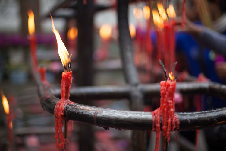 Candles On Metal Holder Outside Temple