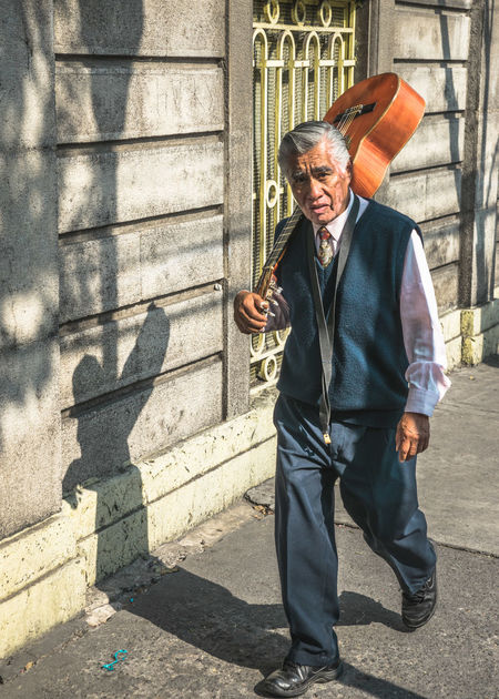 Candid Candid Photography Casual Clothing Composition Day Full Length Guitar Guitarist Jacket Leisure Activity Lifestyles Light And Shadow Mexico Mexico City Neighborhood Old Man Outdoors Passion Portrait Portraits Street Street Musicians Streetphotography Walking