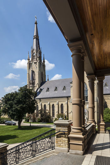 University of Notre Dame USA Color Blue Sky Campus Education Green Christian Culture Famous Knowledge Lawn Religion Science And Technology Tree Main Building Outdoor Sunny Day Vertical Composition Cathedral Golden Tower Building Green Grass University Of Notre Dame University Of Notre Dame U\ USA