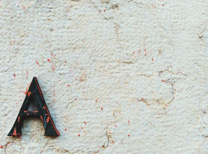 Stains on wall with letter a