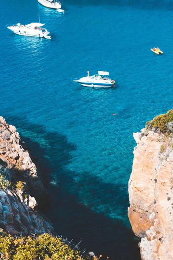 High angle view of sailboats on sea