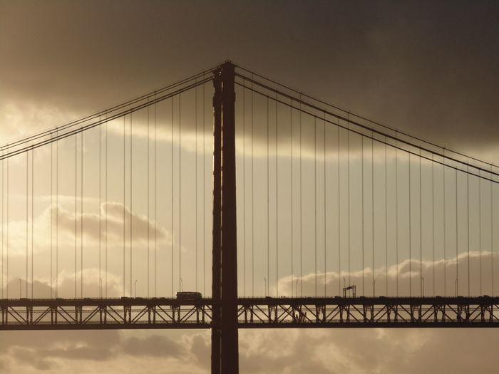 Large bridge against cloudy sky