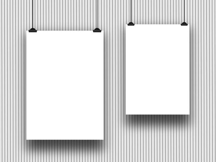 Close-Up Of Empty White Papers Hanging Against Wall