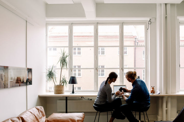 People sitting on table at home