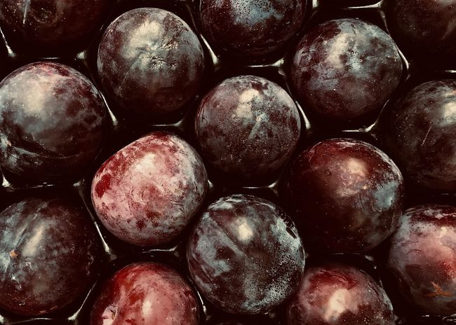 Fresh Plums Food And Drink Healthy Eating Food Wellbeing Fruit Full Frame Freshness Backgrounds Abundance Large Group Of Objects Still Life Textured  Temptation Heap Market Repetition High Angle View Ripe Close-up Lifestyles Warm Colors Baking Cuisine Plum Plums