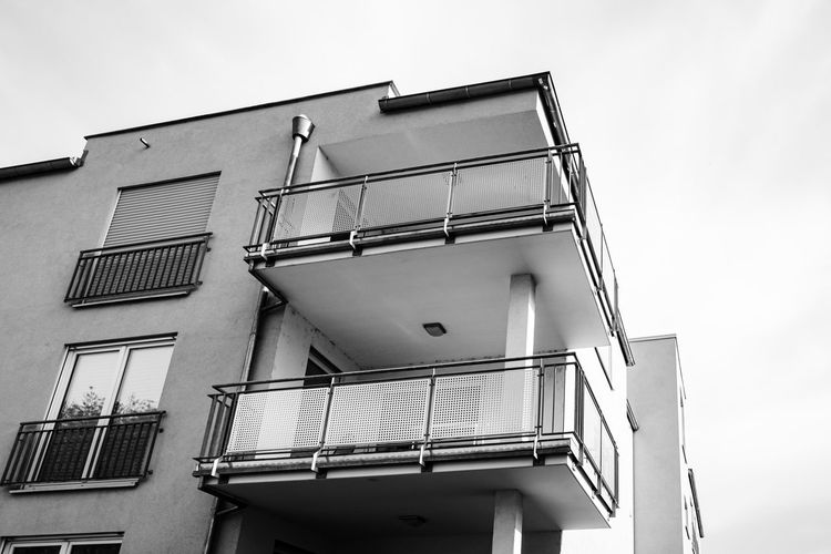 Urban Perspectives Black & White Monochrome Streetphoto_bw Black And White Street Photography Architectural Detail Building Exterior Architecture Built Structure Low Angle View Window Building Sky Day No People Railing Clear Sky Balcony Residential District Safety Security Glass - Material Protection The Devil's In The Detail Urban Photography Architectural Feature