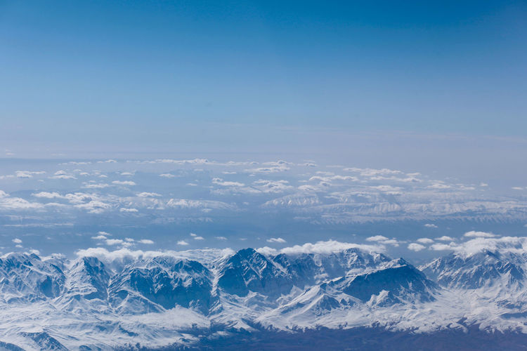 White mountain peaks are covered rays of the setting sun. View from aircraft airplane Aerial View Beauty Beauty In Nature Blue Business Finance And Industry Cloud - Sky Cold Temperature Day Environment Frozen High Up Ice Landscape Nature No People Outdoors Polar Climate Scenics Sky Snow Social Issues Winter The Great Outdoors - 2017 EyeEm Awards