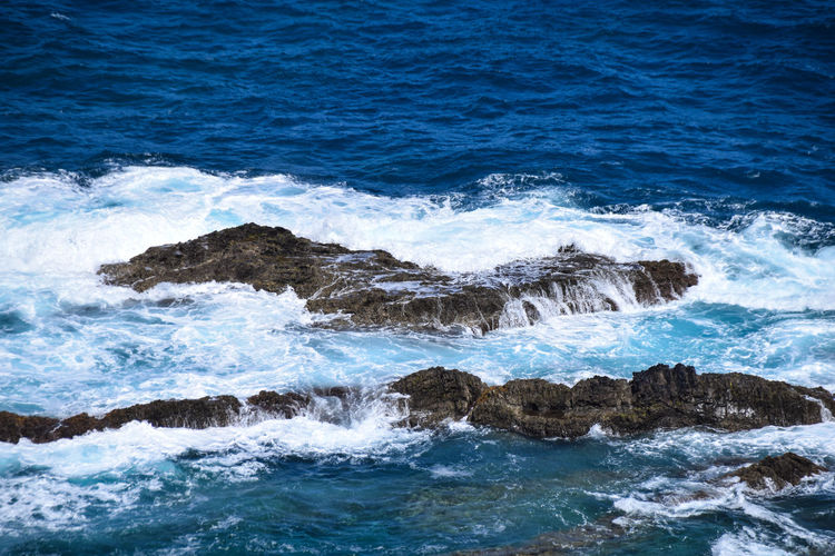 waves breaking over rocks at Fonte de Areia, Porto Santo Fonte De Areia Madeira Ocean Porto Santo Porto Santo Island Portugal Rock Sea Water Wave