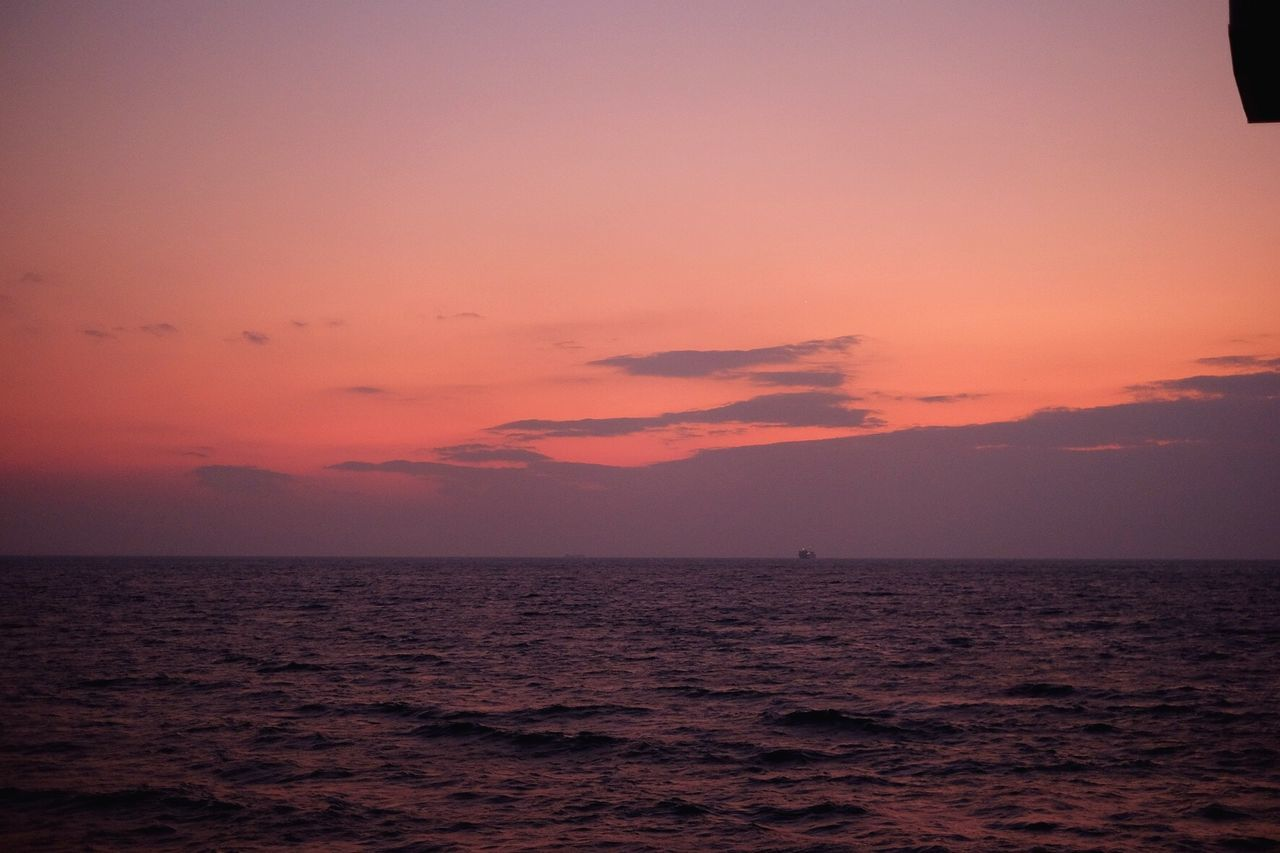 Pink sky and seascape at dusk