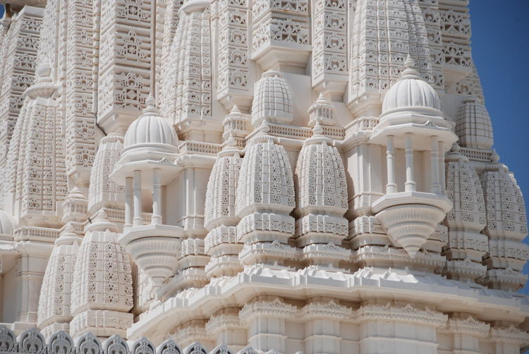 Architecture BAPS Shri Swaminarayan Mandir Hindu Temple Carvings In Stone Fresh On Eyeem  Indian Architecture Indian Temple No People Outdoors Religious Architecture Serenity Sky And Clouds Spiritual Statues Sunny Day White Stone