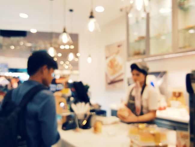 Blurred picture of customer paying money for food and bakery at cashier Customer  Exchange Decoration Blurred Backgrounds Lamp Cafeshop  Bakery Cafe Restaurant Cashier  Cashier Machine Pay Money Light Trade Supermarket Men Working Retail  Store Women Department Store Food Service Occupation