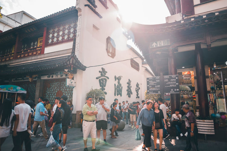 Translate Building Exterior Group Of People Architecture Real People City Built Structure Crowd Women Men Large Group Of People City Life Script Non-western Script Walking Building Lifestyles Street Adult