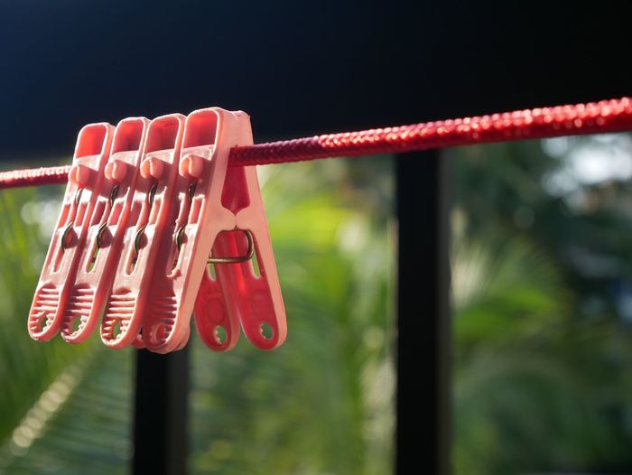 Focus On Foreground Hanging Red Metal Close-up Day No People Protection Text Security Safety Padlock Outdoors Lock Built Structure Railing Communication Nature Wet Hope - Concept