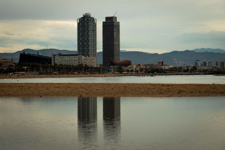 Built Structure Architecture Building Exterior Sky Water City Building Reflection Waterfront Nature Office Building Exterior Cloud - Sky Skyscraper Outdoors No People Day Lake Modern Mountain Cityscape Bay Luxury Barcelona Barceloneta Beach Plage Playa Tower Torrential Rain
