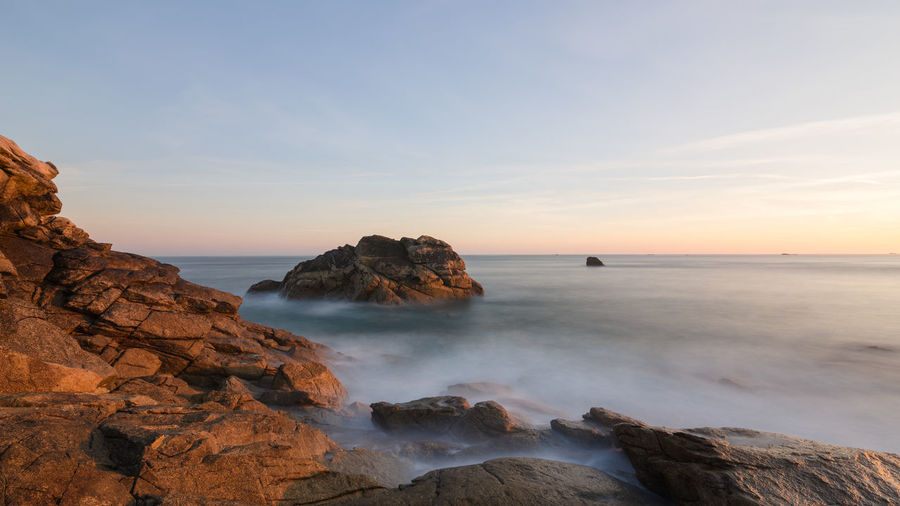 Long exposure of sunrise on the rocky Breton coast in France, Brittany, Finistere Sea Water Sky Rock Scenics - Nature Rock - Object Beauty In Nature Solid Horizon Over Water Tranquil Scene Tranquility Horizon Rock Formation Beach Land Nature No People Idyllic Outdoors Stack Rock Rocky Coastline Bretagne Bretagnetourisme Finistere France Ocean View Coastline Sunrise Long Exposure Tide