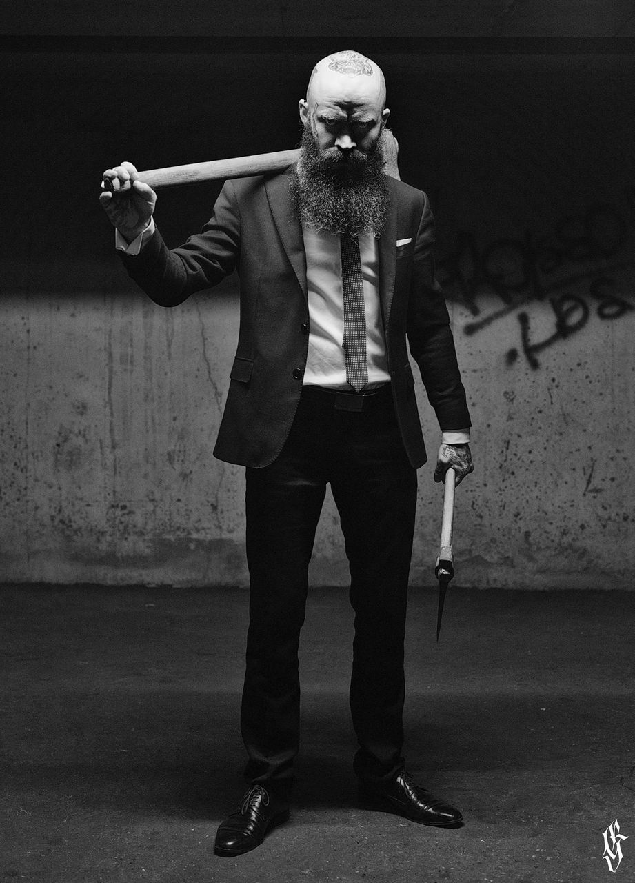 FULL LENGTH PORTRAIT OF SENIOR MAN STANDING ON WALL