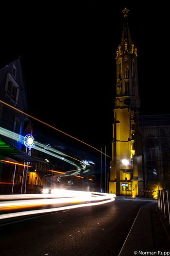 Streetphotography in Walldorf Badenwürttemberg Germany Lights Bus Sap City Cityscapes Night Long Exposure Building Church Tower Traffic Normanrupp Pentax