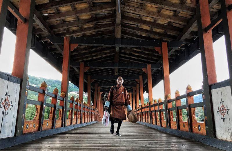 Man walking on footbridge