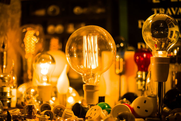 Close-up of illuminated electric bulb on table
