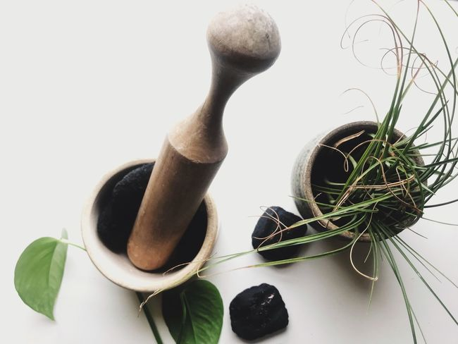 Charcoal with pestle and mortar White Background Studio Shot Leaf No People Indoors  Close-up Day Pestle And Mortar Pestle Mortar Mortar And Pestle Charcoal Health Treatment Remedies Remedy