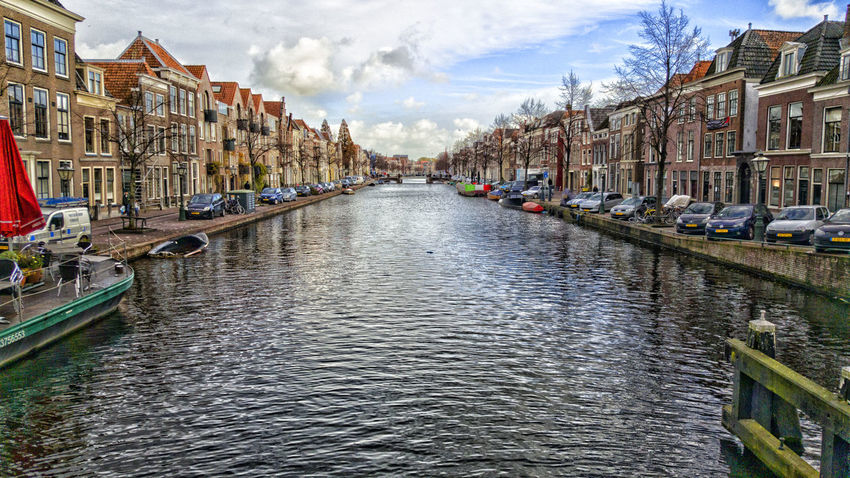 Architecture Building Exterior Built Structure Canal Cloud Cloud - Sky Clouds And Sky Colorful Day Leiden Mode Of Transport Nautical Vessel Netherlands No People Outdoors Sky Transportation Travel Destinations Water
