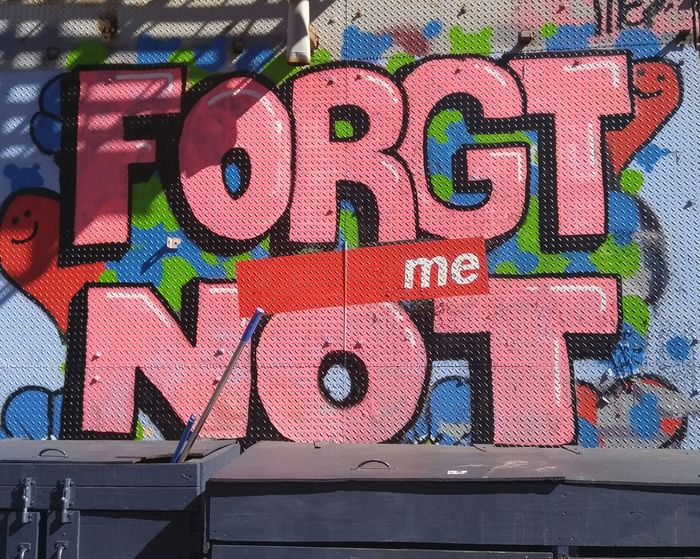 EyeEm Diversity Forget Me Not Graffiti Multi Colored Day Communication Outdoors City Close-up Streetphotography Street Photography City Life Building Exterior Reality Message To The World Message On The Wall Graffiti Art Street Art