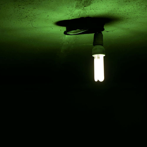 Light bulb in dark room Ceiling Close-up Copy Space Dark Domestic Room Electric Lamp Electric Light Electricity  Fluorescent Light Glowing Illuminated Indoors  Light Light - Natural Phenomenon Light Bulb Lighting Equipment Low Angle View Night No People Wall - Building Feature Water