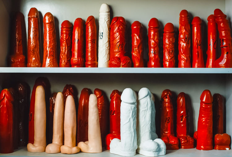 Close-up of dildos on shelf
