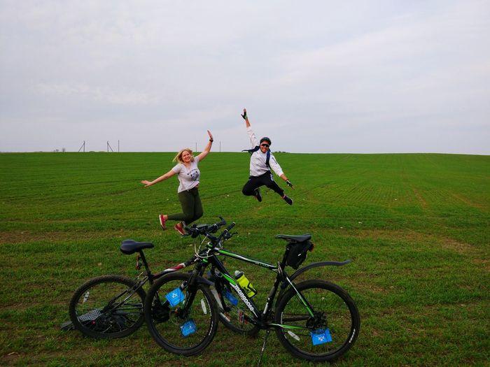Minsk #30daysofbikingby 30daysofbiking Biking Spring Friendship Full Length Togetherness Young Women Bicycle Adventure Bonding Field Standing Sky Cycling Helmet Racing Bicycle Moving Cycling