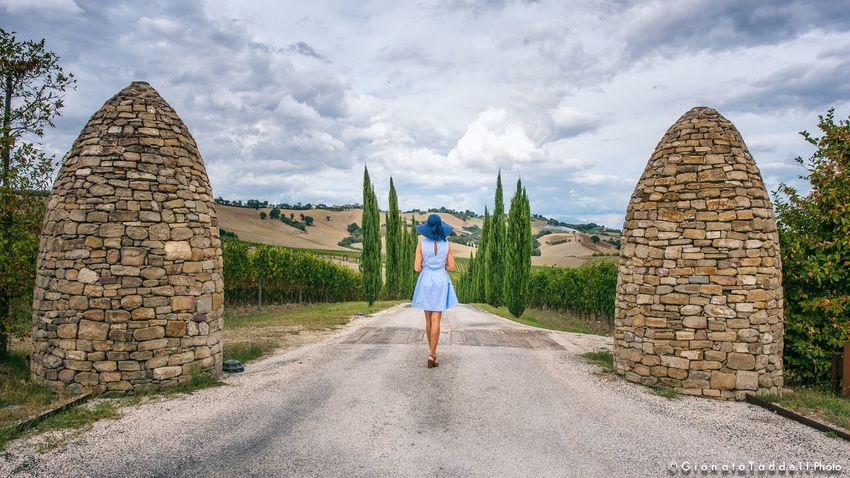 Built Structure Full Length Cloud - Sky Wall - Building Feature Casual Clothing Lifestyles Tourism Tourist Rear View Outdoors Travel Destinations Architecture Marche Countryside Travelgram Person Sky And Clouds Enjoying Life Vacations Paesaggio Travel Photography Paesaggi Nikonphotography nikon Nikon D750