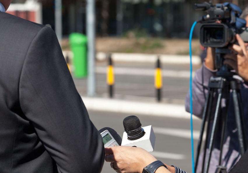 TV interview. News conference. Journalist Mic Press Tv Interview Answering Questions Asking Questions Broadcasting Journalism Communication Holding Human Hand Information Journalism Media Event Media Interview Microphone News Newspaper Occupation Press Conference Report Reporter Television Tv Video Camera