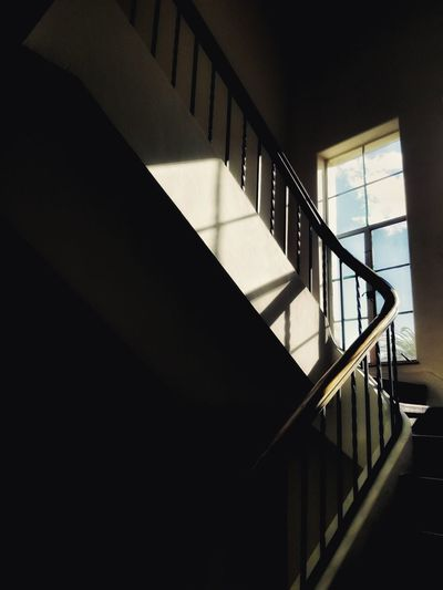 EyeEm Selects EyeEm Best Shots Magical Moments Lines And Angles Window Shadows & Lights Spiral Staircase Hand Rail Stairs Steps And Staircases Spiral Steps Staircase Railing Architecture Built Structure Spiral Stairs Daylight